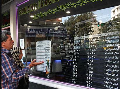 عکس: قیمت دلار در ایران درمقایسه با قیمت قبل از انتخابات 20 درصد کاهش پیدا کرده است / ایران