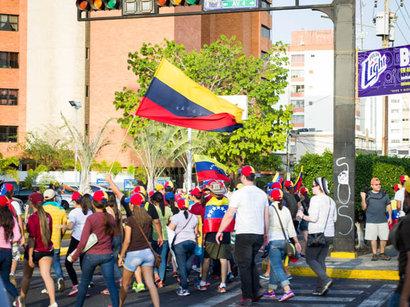 Death toll in Venezuela's unrest rises to 26