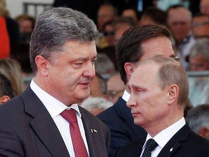 صور: بوتين وبروشينكو يتناولان هاتفياً آخر التطورات بأوكرانيا / سياسة