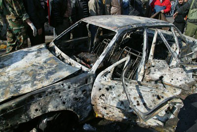 Casualties reported as auto bombs rock Damascus