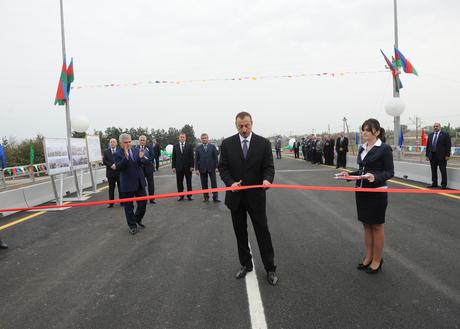 İlham Əliyev Araz çayı üzərindəki körpünün yenidənqurmadan sonra açılışında iştirak edib (FOTO)