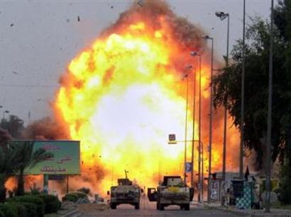 Twin bomb blasts near Iraq's Tikrit kill 23: