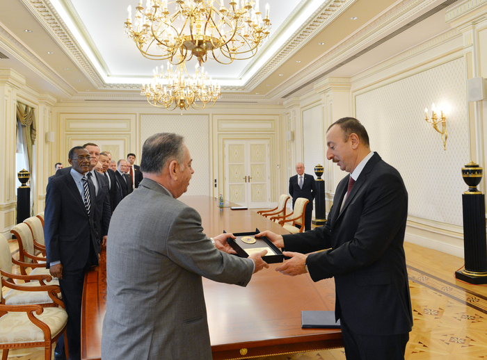 President Ilham Aliyev receives participants of civil defense conference (PHOTO)