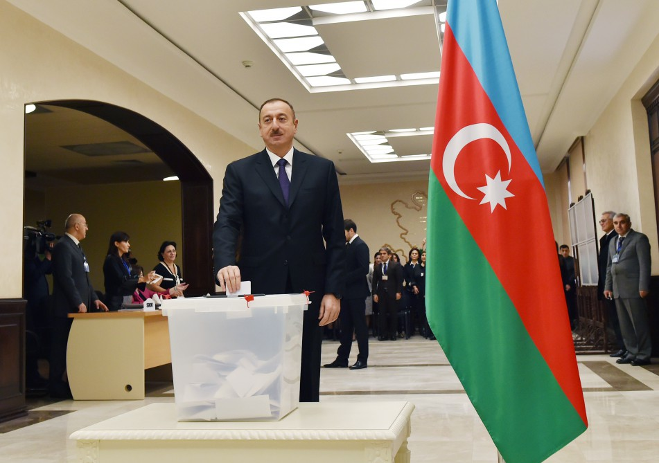 Azerbaijani president, his spouse vote at parliamentary election