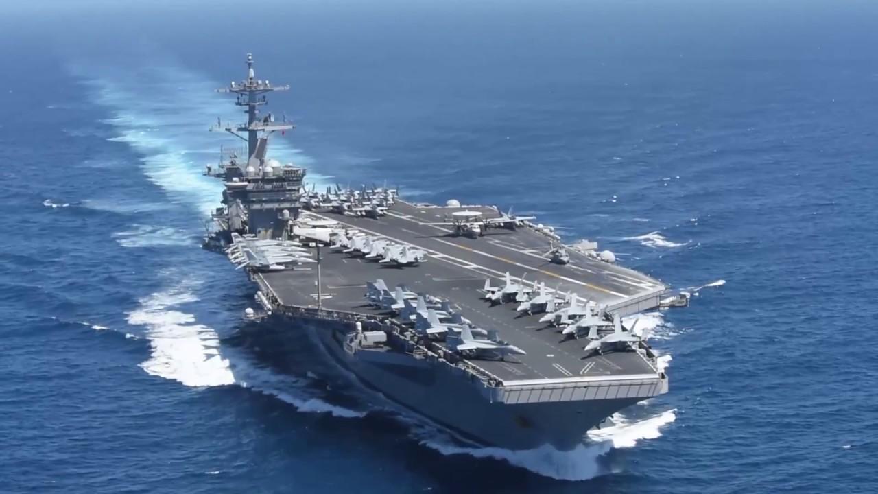Iran says ready to respond, but U S  aircraft carrier no threat