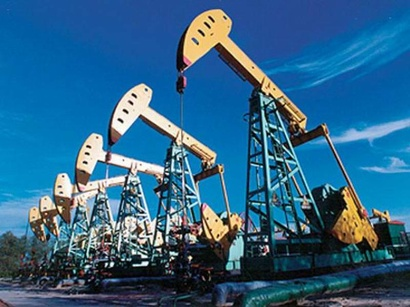 Oil prices weighed down by rising US supplies, but OPEC cuts prevent falls